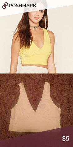 Forever 21 top Plunging ribbed V neck crop top. In yellow. Lighting is just off on phone.  Very cute for summer. Forever 21 Tops Crop Tops