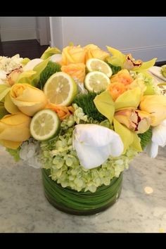 yolanda foster's arrangement.  Mixing citrus and flowers is beautiful.