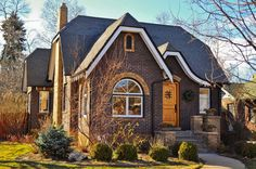 french tudor homes | Craftsman. Two-toned brick with an enclosed porch, this home has ..