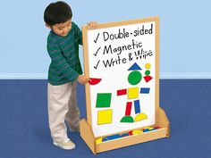 """Stand-Up Magnetic Design Center $79.99 Our design center is so big, kids can stand side by side as they make colorful magnetic patterns! Double-sided wood center has two giant magnetic write & wipe surfaces, plus a super-sturdy base that easily stores tons of magnetic shapes. The design center is 21 3⁄4""""w x 33""""h."""