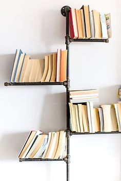 Touring Jacquelyn Clark's Light-Filled Custom Toronto Home Pipe Bookshelf, Bookshelves, Pipe Shelving, Condo Living, Apartment Living, Diy Pipe, Home Interior Design, House Tours, Floor Pillows