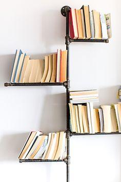 DIY pipe bookshelves -- so cool!