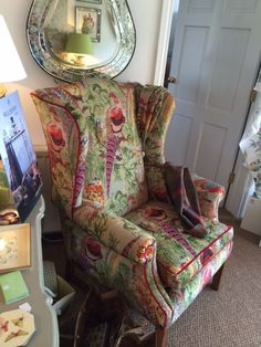 Fabulous chair upholstered in Gamebirds fig, by Mulberry Home