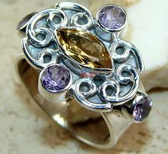 Beautiful item with Citrine Faceted, Amethyst Faceted Gemstone(s) set in pure 925 sterling silver.