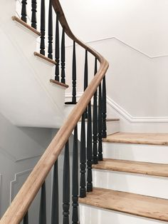 Stewart-Schafer finished the existing staircase and railings by hand. All of the spindles are painted black to give the traditional formwork a modern aesthetic. Tagged: Staircase, Wood Tread, and Wood Railing. Wooden Staircase Design, Painted Staircases, Staircase Railings, Wooden Stairs, Stair Spindles, Spiral Staircases, Staircase Painting, Painted Stair Railings, Staircase Ideas