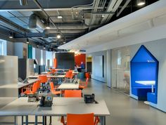 This dynamic space has been carved out of a bland spec office