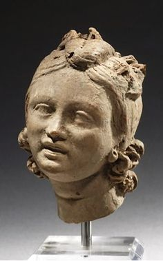 Terracotta head of a young girl. Hellenistic Greek;  2nd Century BC.