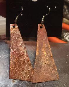 Copper earrings from recycled copper roofing $20.00.  Facebook Kim Powell Louderback