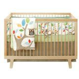 Look at Skip Hop Treetop Friends 4 Piece Crib Set. Observe, when your little one will see the bold graphics featuring a friendly owl and colorful leaves  all around the room, how delightful the baby will be and enjoy the fun of nature.