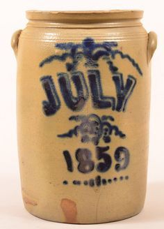 """Rare Unsigned """"July 1859"""" Stoneware Crock. : Lot 461Rare Unsigned """"July 1859"""" Cobalt Blue Slip Decorated Three Gallon Stoneware Pottery Crock. Molded rim, incised bands and ear handles. 14""""h. Condition: Good, with minor chips and a couple of hairlines, interior with lime or calcium build-up. Harry Hartman Sold $8500"""