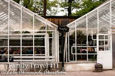 """The kid-friendly """"kafe"""" located inside a large glass greenhouse, surrounded by flower and herb gardens and fruit orchards."""