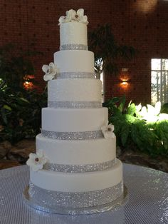 A bit of sparkle.  fondant wedding cake with edible sparkles and rhinestone ribbon