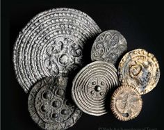 Disc Brooches from Viking York. The prime function of these brooches was as dress fastenings. They were frequently made of base metals, as is the case with all those shown here, but they were often highly decorated.