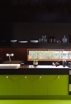 green cabinets and black walls