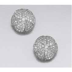 PAIR OF DIAMOND EAR CLIPS Each ear clip of flower head design, the petals alternately set with brilliant-cut diamonds of light pink and near colourless tints, clip fittings.