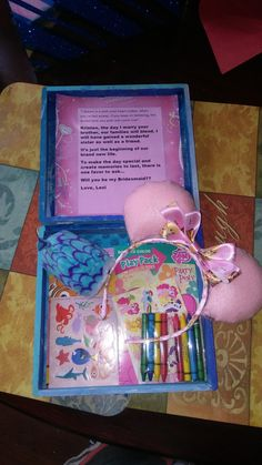 """Will you be my bridesmaid box with Mickey Mouse """"Frozen"""" themed ears."""