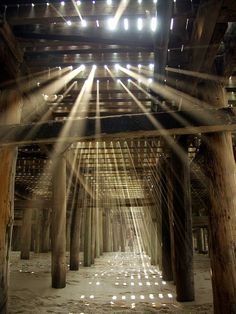 Rays of Sunlight through Ocean Pier