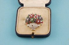 A fine Art-Deco brooch in the form of a basket of