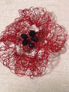 Poppy brooch crocheted with fine wire