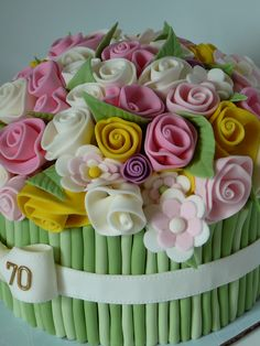 Flower bouquet cake - I saw this design many times an wanted to give it a try. This is a lot of flowers and a lot of fondant!!! Marble cake with chocolate ganache covered with fondant. The details are also fondant.