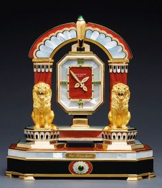 Patek Philippe 'The Ruling Lions' mantel clock, 1992. Yellow gold, diamond, emerald, mother-of-pearl, onyx and jasper.