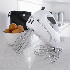 Hand mixer. Any type of hand mixer, nothing fancy, just something that will make mashed potatoes.....