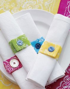 Cute idea for napkin rings.    To fit standard dinner napkins, cut a bandanna into 6- by 9-inch strips. Fold each strip in thirds lengthwise, then fold in thirds widthwise. Sew a button on one end, about 1 inch from the edge. (Choose any colorful loose buttons you may have on hand; they don't need to match.) Then cut a corresponding buttonhole on the opposite end of the strip.