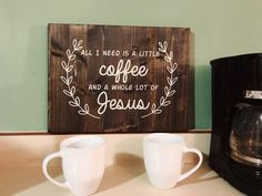 """This is a wonderful bible related wooden sign that says, """"All I need is a little coffee and a whole lot of Jesus."""" This hand painted and stained wood sign would be perfect hanging on a wall or sitting"""