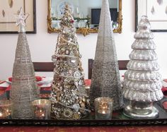 Jeweled Christmas trees made of styrofoam cones covered with jewelry
