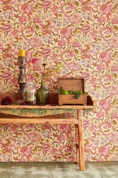 Elegant, textured vinyl wallpaper design  by Eijffinger featuring a trailing pattern of ethnic flowers and leaves.