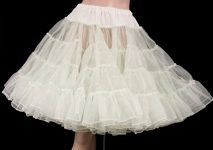Crinoline/net half slips.  I had several of these...  one for each dress my mom made; edging petticoat with same fabric as dress.