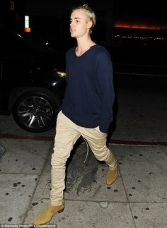Keeping his cool: He dressed down for the occasion in a navy hoodie and loose-fitted chinos