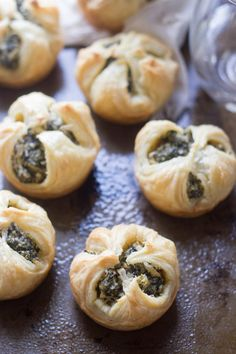 Puff pastry shells are stuffed with spinach, creamy cashew cheese, garlic and dill, and then baked to flaky perfection to make these vegan spinach puffs.
