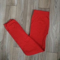Boutique Red fleece leggings Only worn once. Slight pilling it's really not noticeable. Still in great condition. No tags on them. It's a one size fits most but I'd say it fits like a s/m. Make an offer :) Pants Leggings