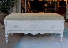 Old dresser turned into upholstered storage bench.
