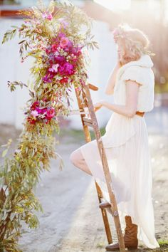 Flower-bedecked ladder | Photo by Happy Confetti Photography