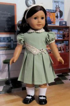 https://flic.kr/p/dUcS9b | 1930's Minty Green Pleated Frock | Another version of the asymmetrical bodice pleated frock. This smart looking little dress is a fresh look for your doll's Spring wardrobe. Its made from a crisp minty green colored cotton with tiny whites dots and a coordinating flowered print. It features an asymmetrical front double overlay bodice trimmed in ivory cluny lace. The peterpan collar is trimmed in lace as well. Very puffy sleeves add a feminine look and the back…