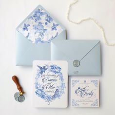 The blue chinoiserie, bird, flowers, dusty blue envelope and silver wax seal.  How we love this wedding stationery, the soft blue color matches perfectly with the silver wax seal on the envelope. One side, the wax adds up a little vintage touch on the final design, but the artwork itself was a fusion, combination between vintage style with modern feel. Since each seal is specially handmade. You can hardly find even two exact same wax seals. #davinoliv