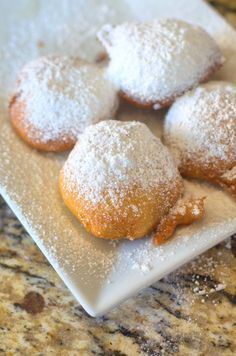 Deep Fried Oreos - Oreos dipped in pancake batter, deep fried, and then topped with powdered sugar.: