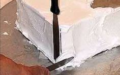 Achieve those elusive sharp corners on your square cakes with this step-by-step tutorial. All you need is two spatulas to create square...