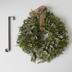 Cedar & Eucalyptus Holiday Wreath with Burlap Ribbon on Provisions by Food52 I Love this wreath.