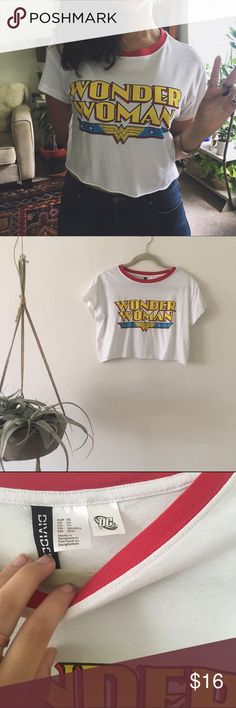 FREE H&M/ wonder woman tshirt WITH PURCHASE OF $20 ITEM/ BUNDLE  ⱝ wonder woman crop top ⱝ soft, cottony material ⱝ divided for h&m ⱝ best fits xsmall/ small, poss med ⱝ excellent condition    » I DO NOT LOWER MY PRICES, SO OFFERS ARE ABSOLUTELY WELCOME  » UNLESS IT IS FOR A BUNDLE, I WILL NOT RESPOND TO OFFERS IN COMMENTS   » I WILL MAKE A NEW LISTING FOR DISCOUNTED SHIPPING H&M Tops