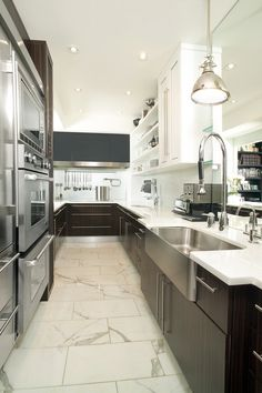 Great Galley Kitchen  Toronto home of designer Mel Quilitan - Tomas Pearce Interior Design. Arnal Photography.