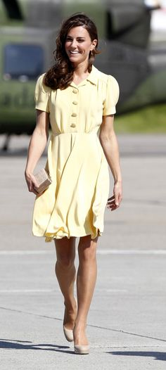 Kate wore this vibrant primrose yellow silk Jenny Packham dress upon her arrival in Calgary, Alberta, on July 7, 2011. She paired it with her nude LK Bennett pumps and straw-colored LK Bennet clutch.    16      2