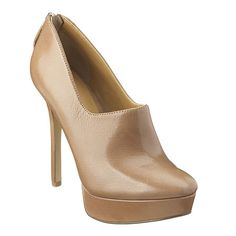 """As seen in the October issue of Cosmo.....Almond toe platform shootie with exposed zipper closure.  Leather upper.  Measurements: heel 4.5"""" and platform 1""""."""