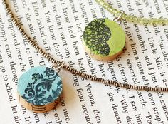 Wine Cork Pendant Necklaces-  Pull out those wine corks you have been saving and put them to use making fun upcycled pendants!