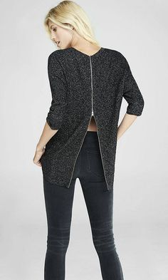 Gifts Under $50: A textured knit that's lifted by the sparkle of metallic thread with a sharp exposed back zip detail and elegant hi-lo silhouette that make this sweater a must-have. Try it with scuba leggings and boots.
