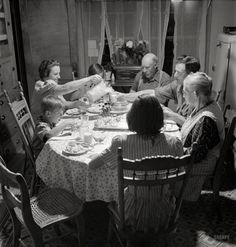 """July 1942. """"East Montpelier, Vermont. The Charles Ormsbee family and his widowed mother, Mrs. Myrtle Ormsbee, at dinner."""" Photo by Fritz Henle for the Office of War Information."""