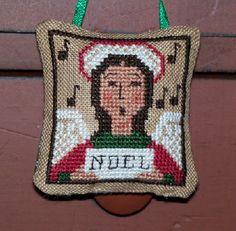 Cross stitch Christmas Angel ornament. Design by The Prairie Schooler.