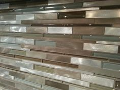 Our kitchen tile backsplash is a mixed glass and metal tile backsplash. Available at Lowes of all places. Turned out beautiful!
